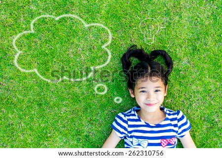 A cute little girl with graphics of idea and imagination: Dream idea of a kid  - stock photo