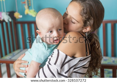 A Cute newborn baby with his sister - stock photo