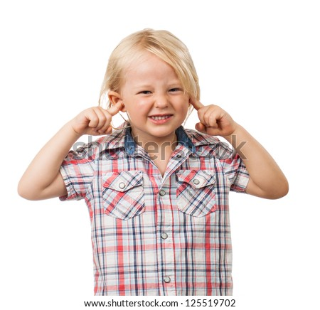 A cute sad boy looking distressed and blocking his ears with his fingers. Isolated on white. - stock photo