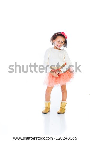 A cute young African American Girl with a sassy attitude. - stock photo