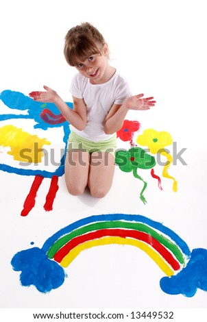 A cute young girl painting a picture - stock photo