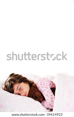 A cute young girl sleeping with her teddy bear,copy space - stock photo