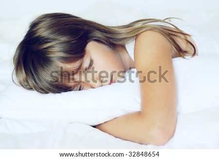 A cute young girl taking a nap - stock photo