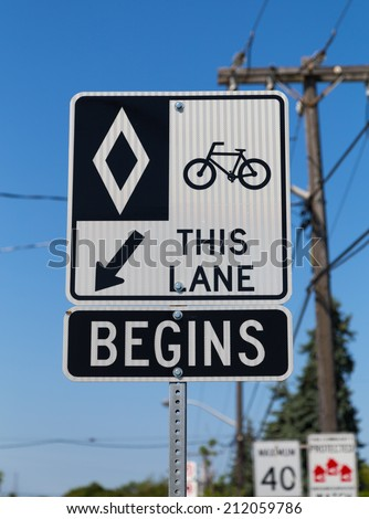 A cycle Lane in Toronto showing a sign and road markings - stock photo