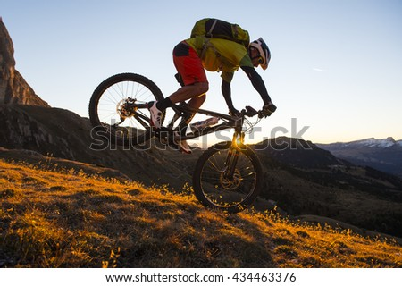 A cyclist young male riding a mountain bike outdoor - stock photo