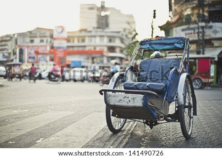 A cyclo parked on the side street - stock photo