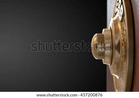 A 3D render of a vintage brass doorbell on an isolated wooden background