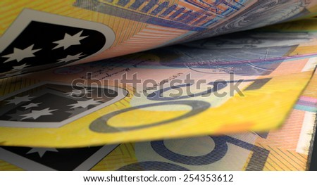 A 3D rendering of a macro close-up view showing the detail in between two separated australian dollar banknotes - stock photo