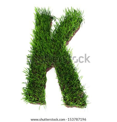 A 3D rendering of an upper case K in grass - stock photo
