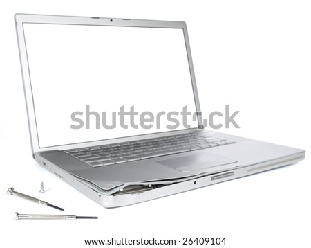 A damaged laptop computer is about to be fixed with a pair of clockwork screwdrivers. Isolated on white. - stock photo