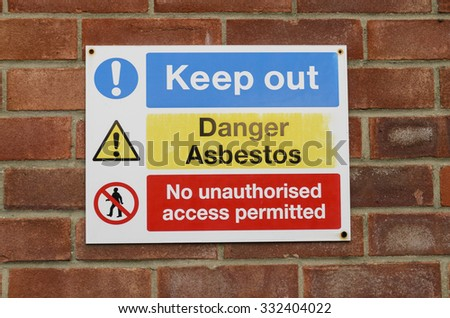 A danger sign for asbestos hazard keep out, England UK. - stock photo