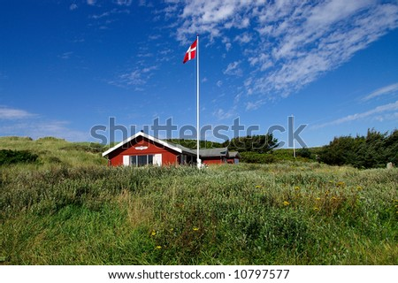 A danish summerhouse with bushes in the front - stock photo