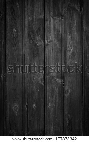 A dark grungy wooden background. Vigened added. - stock photo