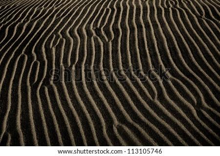 A Dark Sand Ripple Nature Background, Death Valley; California, USA - stock photo