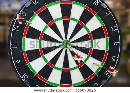 A dartboard close-up with a bullseye hits. - stock photo