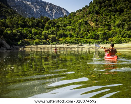 a day in canoa in the Cedrino, river of sardinia. - stock photo