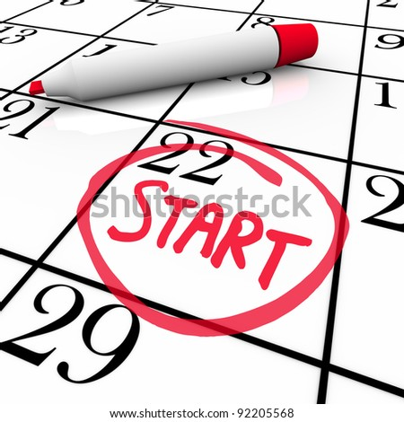 A day with the word Start circled on a calendar to mark the beginning of a new job, school semester or other significant event - stock photo