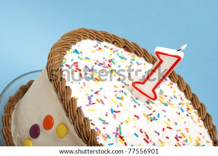 A decorated cake rests on a blue background to celebrate many occasions. - stock photo