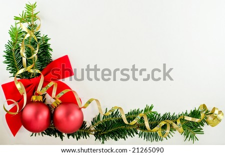 A decorative L-shaped border/corner with ribbon, baubles and greenery against a white background.