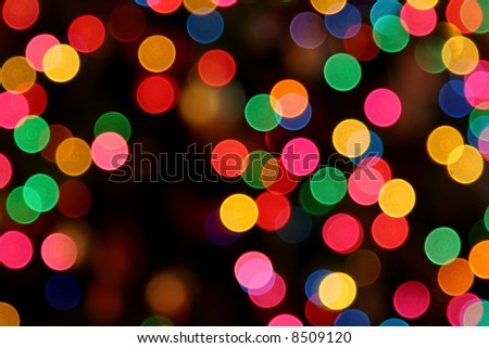 A defocused shot of Christmas lights. - stock photo