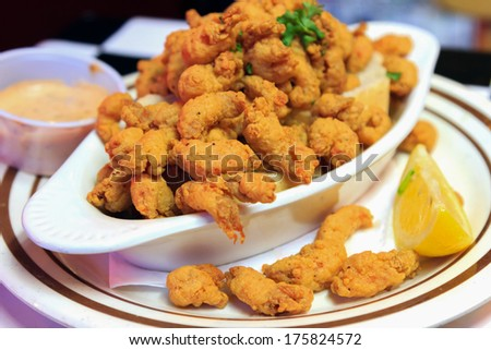 A delicious appetizer plate of New Orleans style Crawfish with dipping sauce and lemon - stock photo