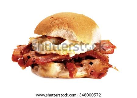 A delicious bacon and egg bun on a white background. Bacon and egg bun. - stock photo