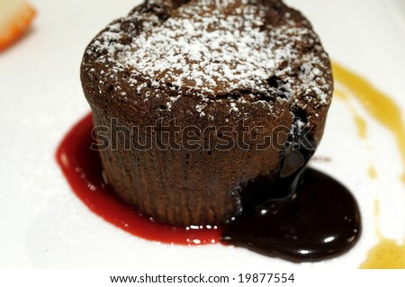 A delicious chocolate cake oozing its chocolate center
