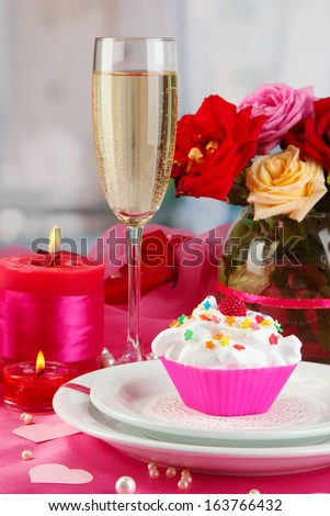 A delicious creamy dessert on celebratory table of Valentine's Day on room background