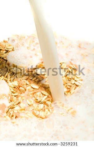 A delicious healthy bowl of muesli With milk - stock photo