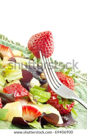 A delicious low fat fruit salad with fresh strawberries, apples and cranberries, covered in Raspberry Vinaigrette Dressing, selective focus - stock photo