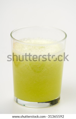 a delicious melon milkshake isolated over white