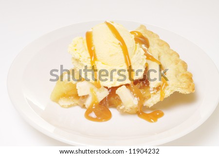 A delicious slice of apple pie topped with vanilla ice cream and drizzled with caramel sauce.