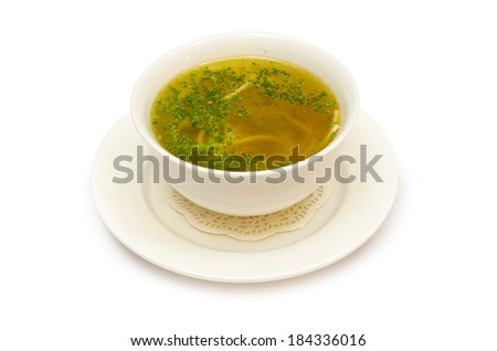 a delicious soup broth with noodles and herbs and isolated on white background - stock photo
