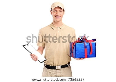 A delivery person delivering a big gift box isolated on white background - stock photo