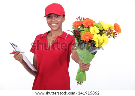 a delivery woman bringing a flowers bouquet