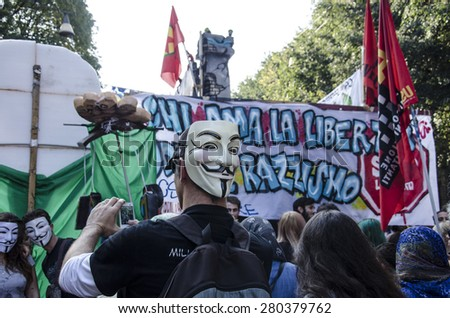 A demonstrator with Anonymous mask during the 'anti-racist' demonstration in opposition to the 'No invasion' march recently held by the Lega Nord, and organized to combat immigration. - stock photo