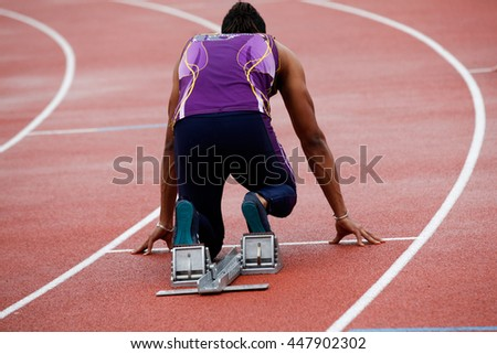 A departure of an athlete on a running track
