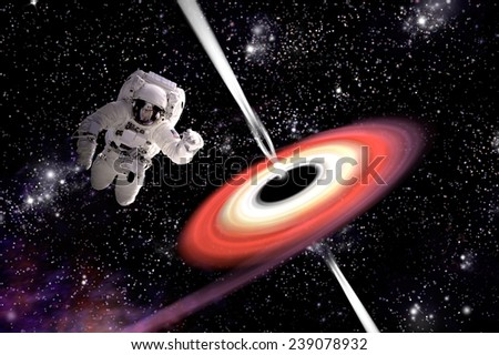 A depiction of an astronaut falling towards a black hole in outer space. Gamma Rays erupt from the poles as a nearby nebula is pulled in. Elements of this Image Furnished by NASA. - stock photo