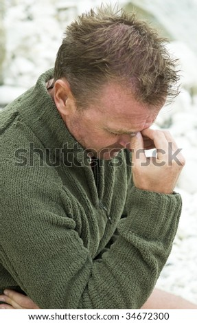a depressed and dejected forties man. - stock photo