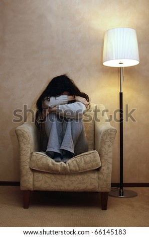 A depressed woman with a closed position