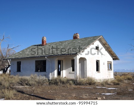 A derelict home in a western ghost town. - stock photo