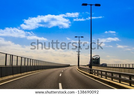 A deserted freeway leads to nowhere. - stock photo