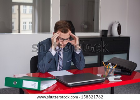 A desperate young businessman in the office. - stock photo