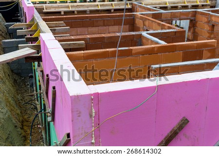 a detached house is built in solid construction with brick. thermal insulation is applied. - stock photo