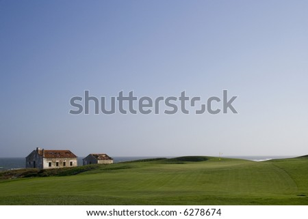 a detail a golf course next to the ocean - stock photo
