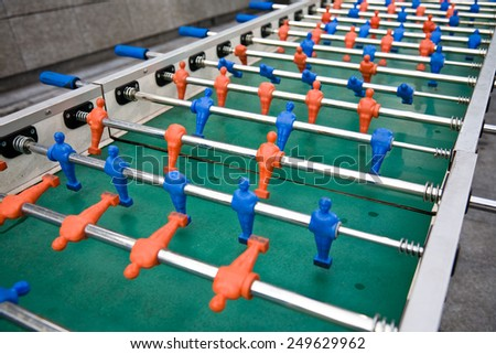 A detail of a long table for playing table soccer - stock photo