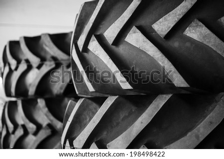 A detail of a row of rubber tractor tires - stock photo