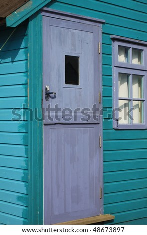 A detail of a turquoise wooden painted coastal beach hut. location in Christchurch, Hampshire UK. - stock photo