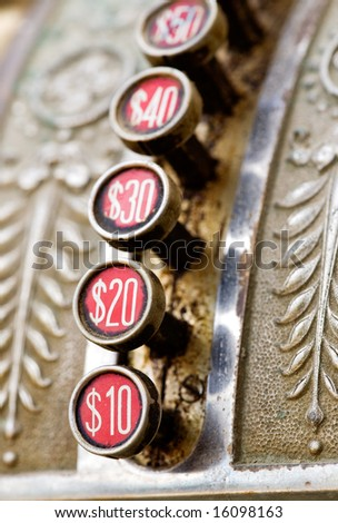 A detail of a vintage dirty cash register - stock photo