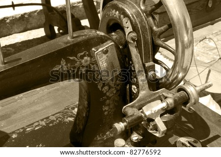 a detail of an ancient sewing machine manual in sepia - stock photo